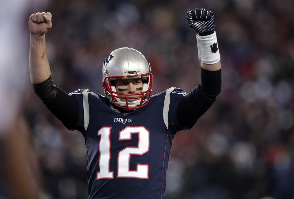 New England Patriots quarterback Tom Brady celebrates a touchdown against the Titans. (AP)