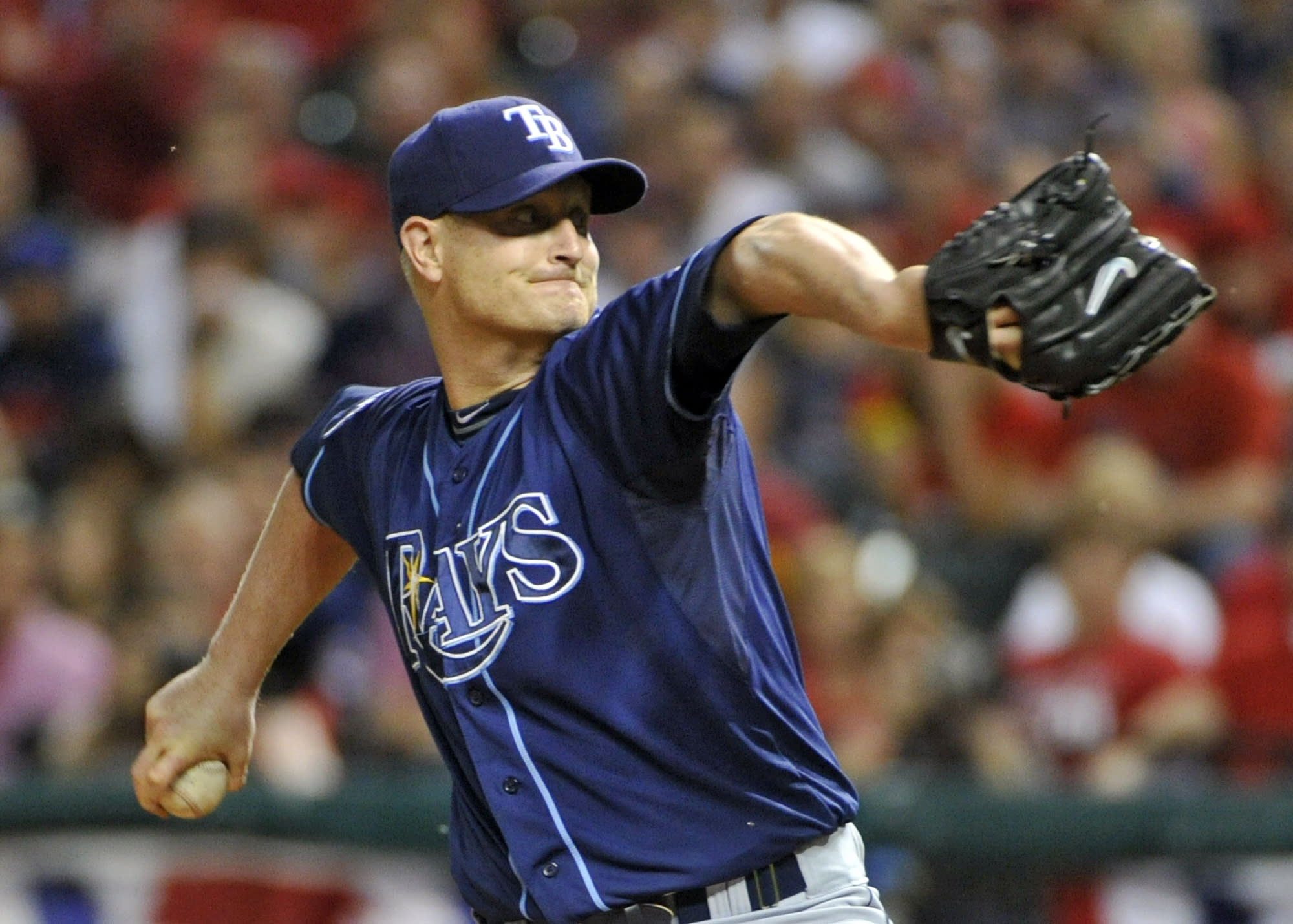 Tampa Bay Rays starting pitcher Alex Cobb winds up against the Cleveland Indians in the first inning of the AL wild-card baseball playoff game Wednesday, Oct. 2, 2013, in Cleveland. (AP Photo/Phil Long)