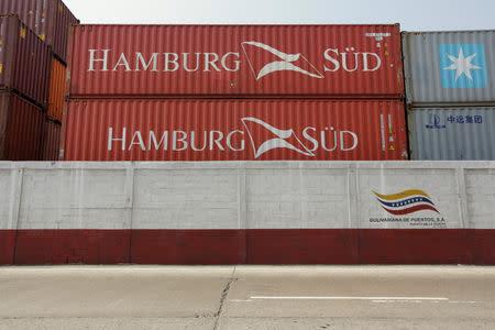 Containers from Hamburg Sud Shipping Company are seen at La Guaira port, in La Guaira
