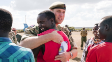 Prince William shows off his football skills as he joins the Irish Guards in Kenya