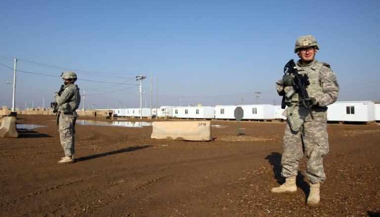 US soldiers keep guard at the Taji base which houses American and Iraqi troops north of the capital Baghdad (AFP Photo/ALI AL-SAADI)