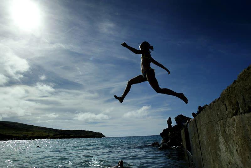 "FILE PHOTO: A NATIVE ""RAPA NUI""GIRL JUMPS TO THE SEA ON EASTER ISLAND."