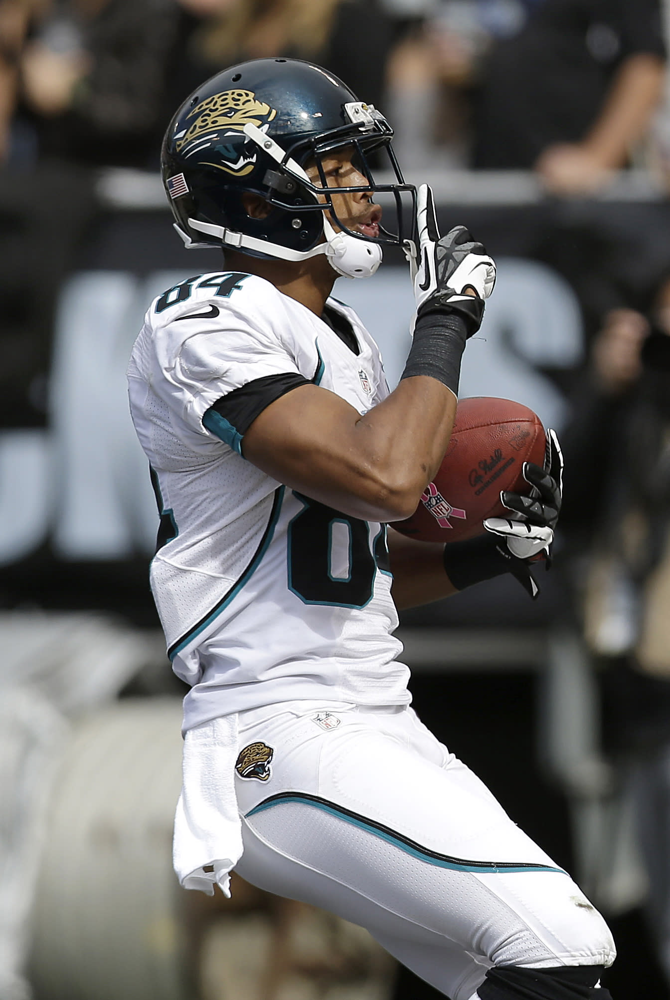 Jacksonville Jaguars wide receiver Cecil Shorts (84) celebrates after scoring on a 42-yard touchdown reception against the Oakland Raiders during the first quarter of an NFL football game, Sunday, Oct. 21, 2012, in Oakland, Calif. (AP Photo/Marcio Jose Sanchez)