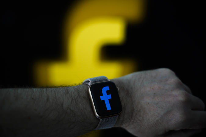 The Facebook logo is seen on an Apple Watch in this photo illustration in Warsaw, Poland on April 25, 2019. (Photo by Jaap Arriens/NurPhoto via Getty Images)