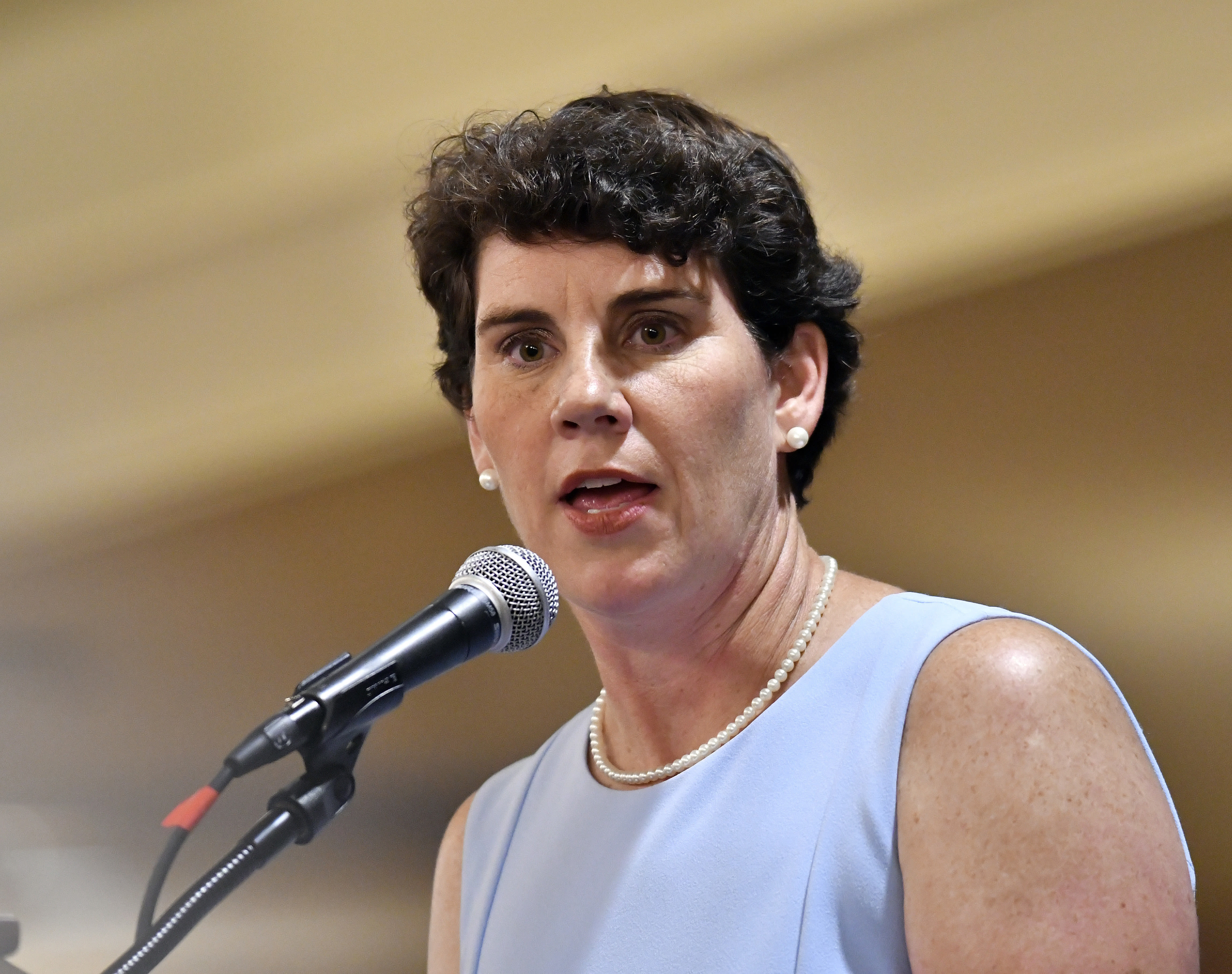 FILE - In this Aug. 18, 2018, file photo, Amy McGrath, a Kentucky Democratic candidate for Congress, speaks to supporters during the 26th annual Wendell Ford Dinner in Louisville, Ky. Democrat Amy McGrath has raised more money than Republican U.S. Rep. Andy Barr in Kentucky's 6th Congressional district. McGrath has raised more than $6 million while Barr has raised more than $4 million. (AP Photo/Timothy D. Easley, File)