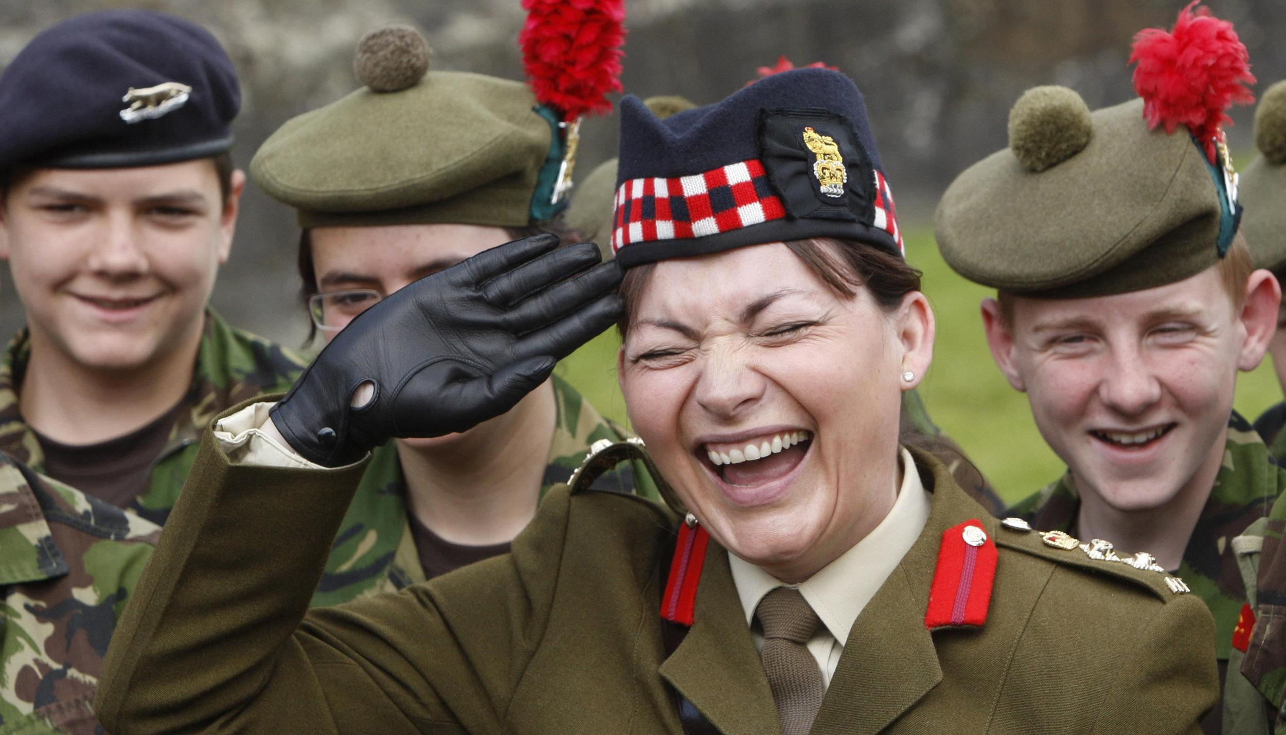 Television presenter and honorary Black Watch colonel Lorraine Kelly laughs as she inspects officer duties at the Royal Gun salute to mark the Queen's birthday at Stirling Castle in Scotland.