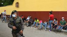 Guatemala sends over 3,000 Honduran migrants home from caravan