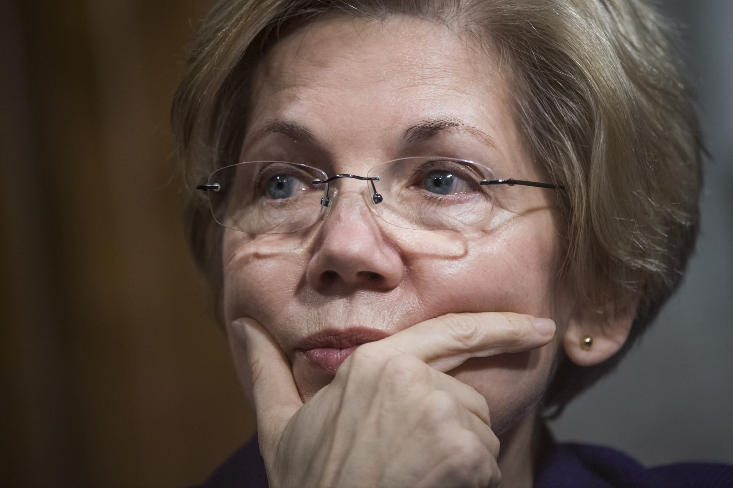 <p>Sen. Elizabeth Warren, D-Mass., attends a Senate Armed Services Committee hearing in Dirksen Building titled 'Foreign Cyber Threats to the United States,' featuring testimony by Director of National Intelligence James Clapper and others, January 5, 2016.</p>  <p>(Photo By Tom Williams/CQ Roll Call)</p>