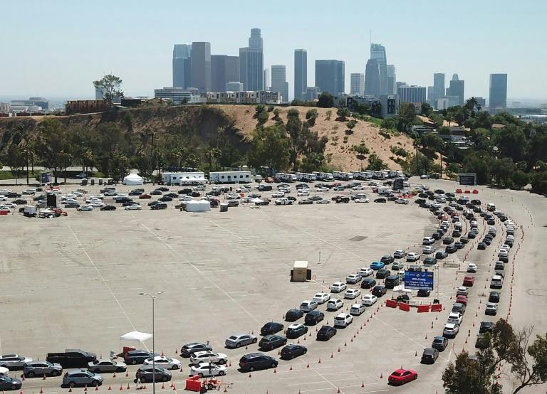 Cars queue at a coronavirus testing site in Los Angeles, California, where authorities have reimposed containment measures owing to fresh spikes in the disease
