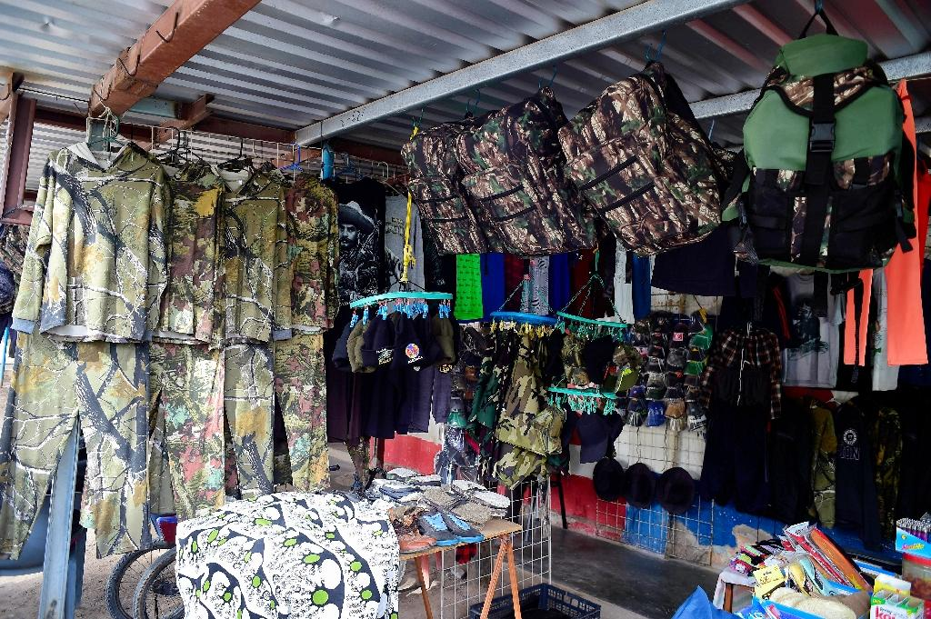 Camouflage gear is offered for sale in Sonora state, Mexico, to migrants heading to the United States (AFP Photo/ALFREDO ESTRELLA)
