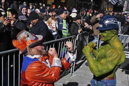 A fan of Seattle Seahawks jokes with a fan of Denver Broncos at the Super Bowl Boulevard fan zone ahead of Super Bowl XLVIII in New York