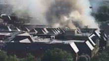 Major incident declared as 100 firefighters tackle shopping centre blaze