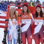 Gisin holds off Shiffrin to claim combined gold