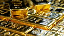 Gold dips 1 percent as no-deal Brexit fears fade, dollar rises