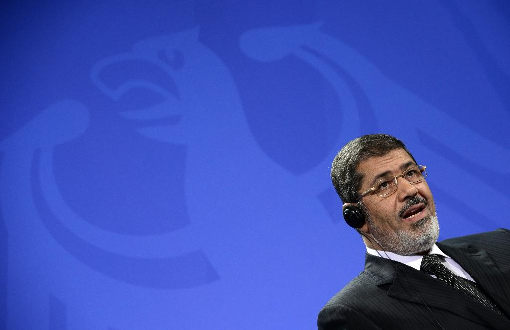 Former Egyptian president Mohamed Morsi gives a press conference in Berlin in January 2013 (AFP Photo/John Macdougall)