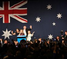 Australia's conservatives secure majority government: ABC