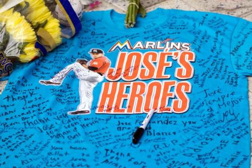 A remembrance shirt at a makeshift memorial in honor of Jose Fernandez sits outside Marlins Park, Sunday, Sept. 25, 2016. (AP Photo/Gaston De Cardenas)