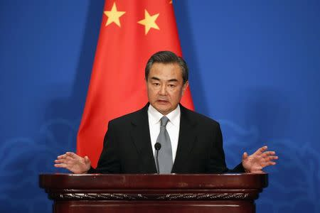 Chinese Foreign Minister Wang Yi attends a news conference after the 13th Russia-India-China Foreign Ministers' Meeting, at Diaoyutai State Guesthouse in Beijing