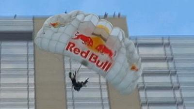 Raw: Base Jumpers Leap Off 45-Story Denver Hotel