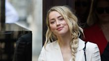 Amber Heard admits 'hitting' Johnny Depp and says she tried to 'escape him'
