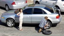 Why heartwarming photo of man changing woman's tyre is going viral