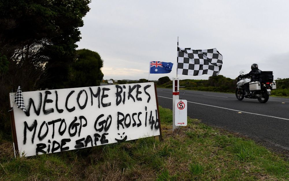 A sign created by Phillip Island local Jamie Rodger-Murray, who also mows a message in his lawn