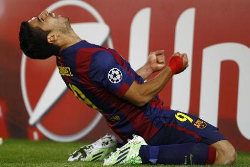 El delantero uruguayo del Barcelona, Luis Suárez, celebra su gol ante el París Saint-Germain (3-1) el 10 de diciembre de 2014 en el Camp Nou, en Barcelona