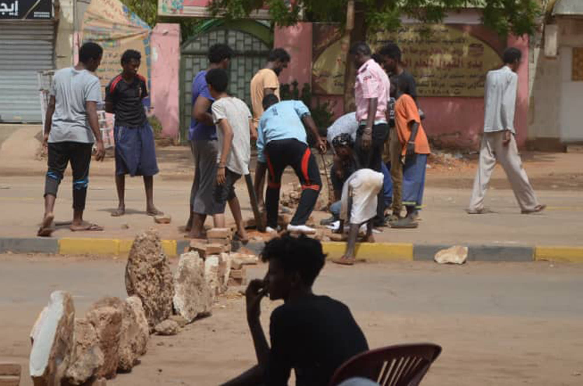 Bricks are laid by protesters to block a street in the Sudanese capital Khartoum to stop military vehicles from driving through the area on Wednesday, June 5, 2019. The death toll in Sudan amid a violent crackdown on pro-democracy protesters and the dispersal of their peaceful sit-in earlier this week in the capital climbed on Wednesday, protest organizers said. (Mohammed Najib via AP)