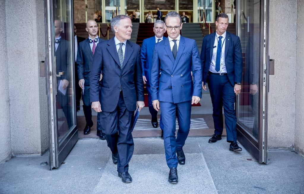 German Foreign Minister Heiko Maas (R) and his Italian counterpart Enzo Moavero Milanesi discussed the EU migrant crisis in Berlin (AFP Photo/Michael Kappeler)