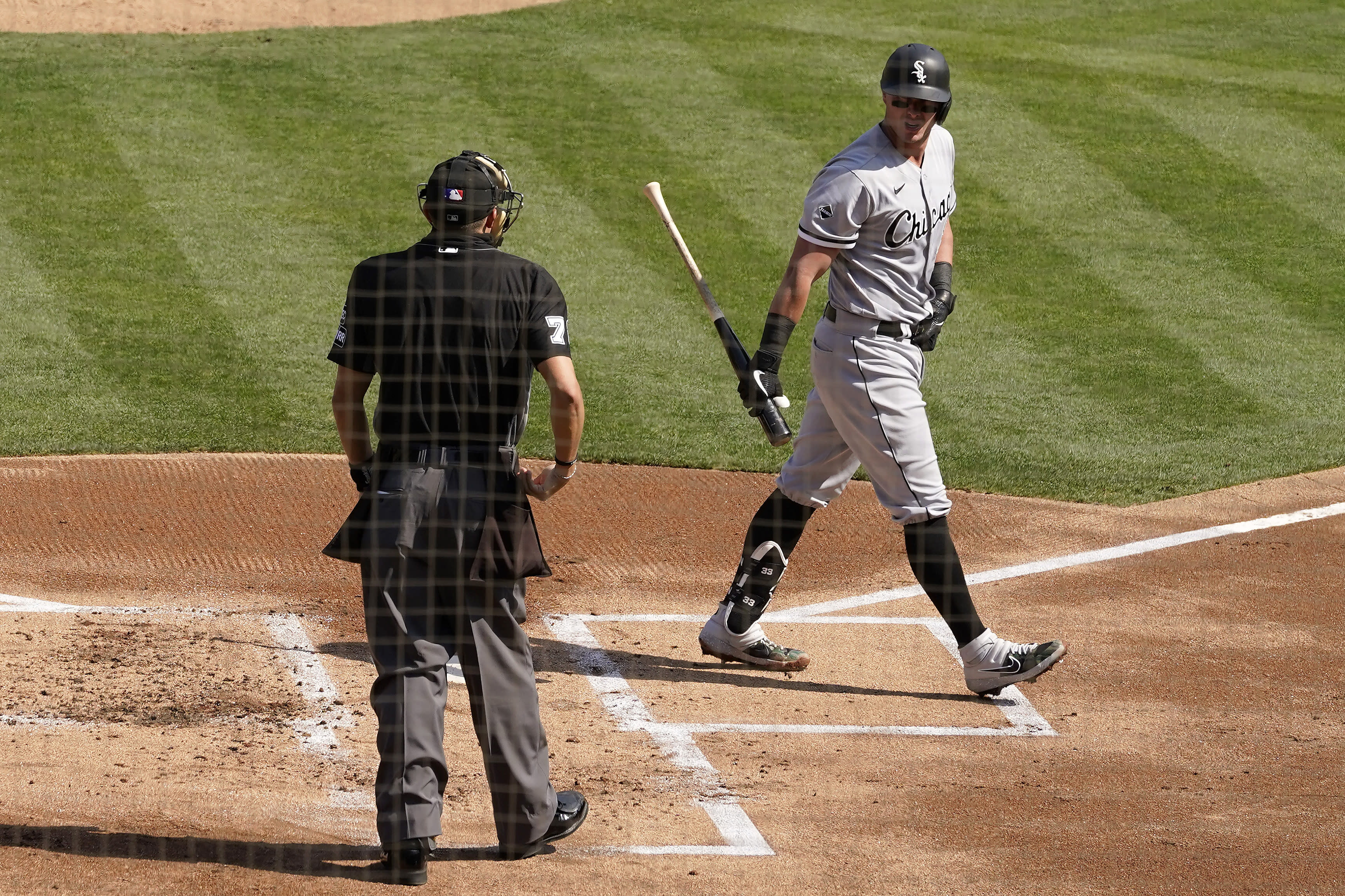 Chicago White Sox's James McCann, right, reacts toward umpire Adam Hamari after striking out against the Oakland Athletics during the first inning of Game 1 of an American League wild-card baseball series Tuesday, Sept. 29, 2020, in Oakland, Calif. (AP Photo/Eric Risberg)