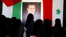 Special Report: A collapsing economy and a family feud pile pressure on Syria's Assad