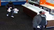 Surveillance photos released of robbery suspects
