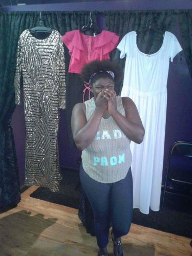 Emotion overwhelms Gooden Brown as she picks out a dress. (Photo: Quinniya Hearn)
