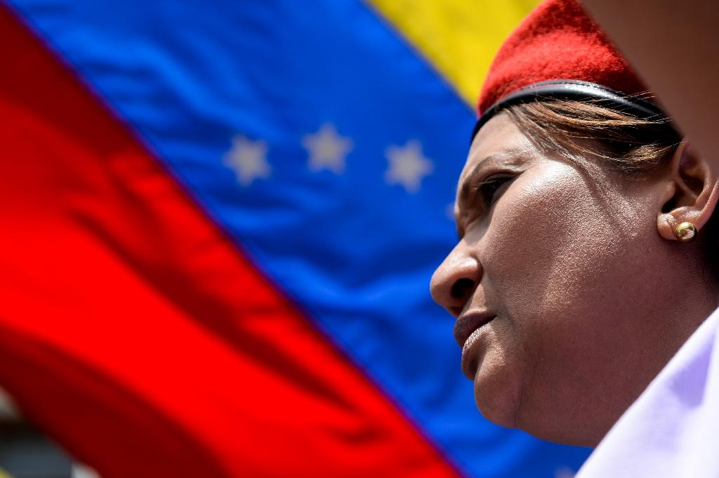 A supporter of Venezuelan President Nicolas Maduro takes part in a rally in Caracas, on May 22, 2017 (AFP Photo/FEDERICO PARRA)