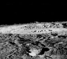 Surface Water Seen Trapped in Rocks on the Moon