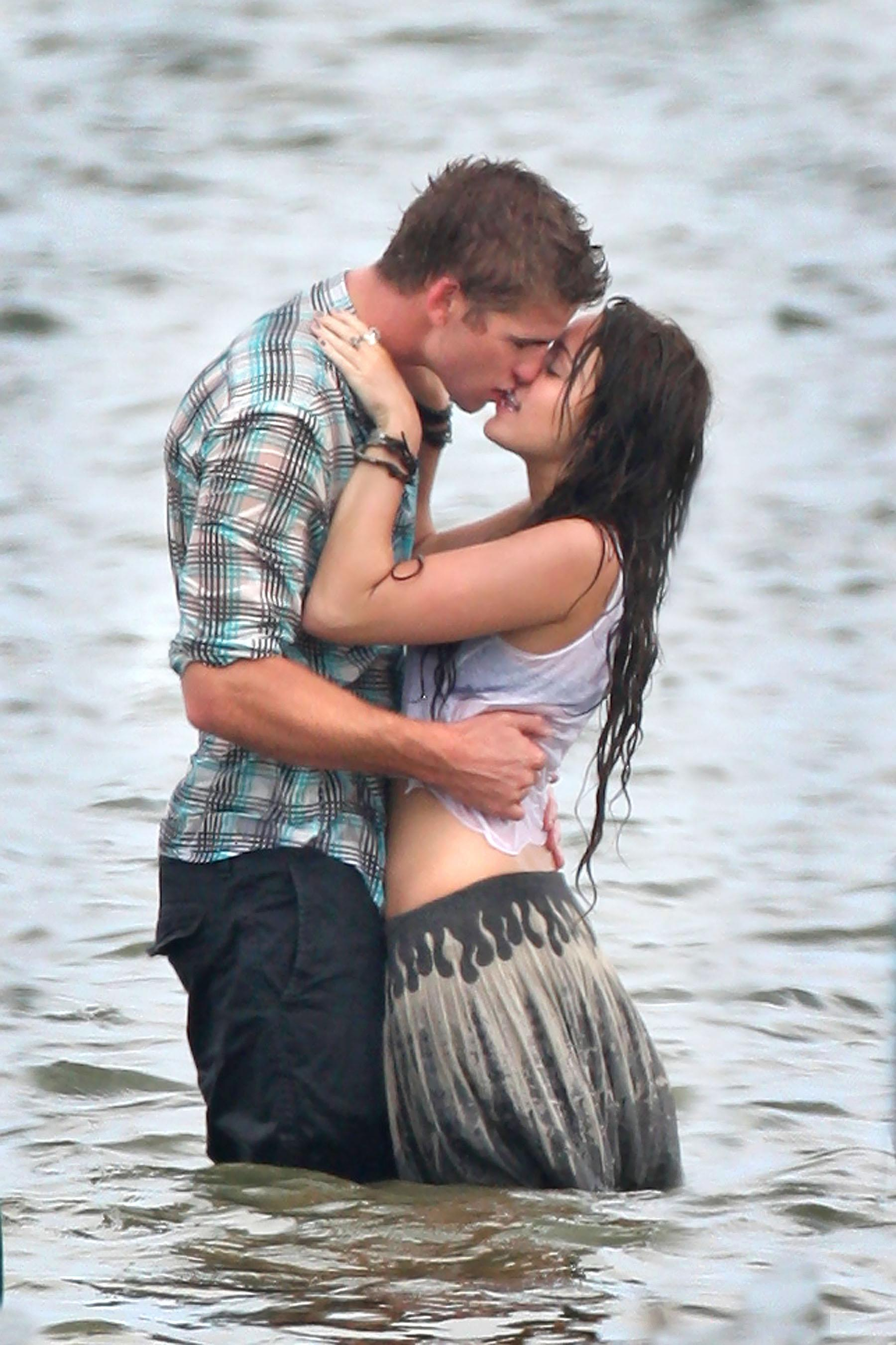 Miley Cyrus Shares Throwback Photo Of Her First Smooch With Liam Hemsworth For International Kissing Day