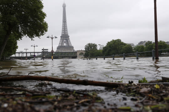 <p>View of the flooded river-side of the River Seine near the Eiffel tower in Paris, France, after days of almost non-stop rain caused flooding in the country, June 3, 2016. (REUTERS/Philippe Wojazer) </p>
