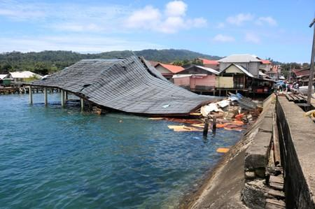 A damaged traditional market building is pictured following an earthquake in Ambon