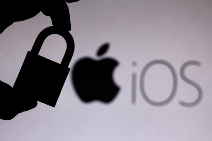 BRAZIL - 2020/07/11: In this photo illustration a padlock appears next to the iOS (Apple) logo. Online data protection/breach concept. Internet privacy issues. (Photo Illustration by Rafael Henrique/SOPA Images/LightRocket via Getty Images)