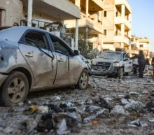 Syria regime kills 20 civilians, retakes symbolic town