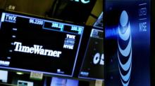 AT&T fires back in bid to preserve its deal with Time Warner