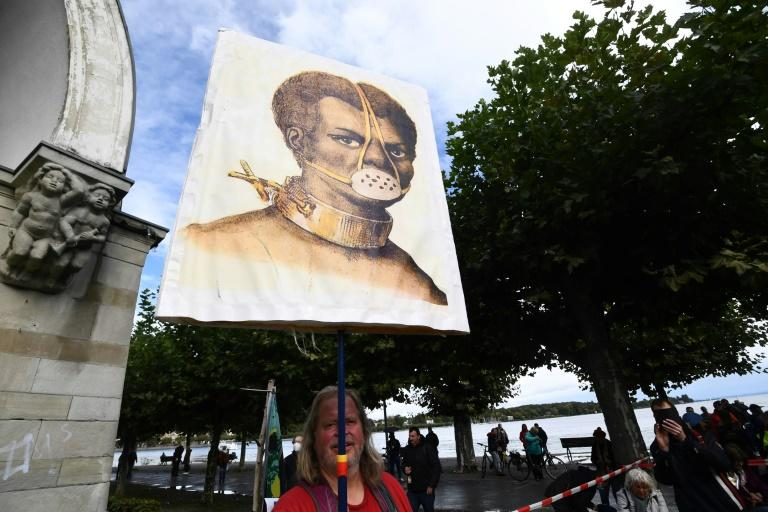 German anti-mask rally fails to ignite at Alpine lake