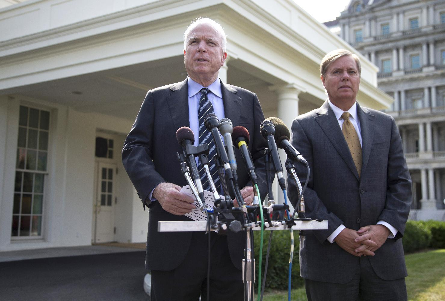 Sen. John McCain, R-Ariz., left, accompanied by Sen. Lindsey Graham, R-S.C., speaks with reporters outside the White House in Washington, Monday, Sept. 2, 2013, following a closed-door meeting with President Barack Obama to discuss the situation with Syria. President Barack Obama, working to persuade skeptical lawmakers to endorse a U.S. military intervention in civil war-wracked Syria, hosted the two leading Capitol Hill foreign policy hawks for talks and directed his national security team to testify before Congress in a determined effort to sell his plan for limited missile strikes against Syrian President Bashar Assad's regime. (AP Photo/Evan Vucci)