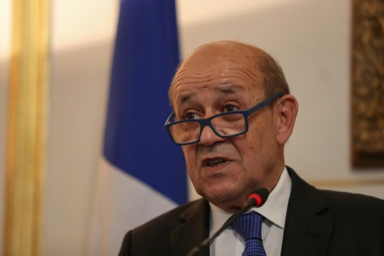 French investigators say tricksters tried to impersonate Jean-Yves Le Drian when he was France's defence minister in 2015 and 2016. (AFP Photo/Mohamed el-Shahed)