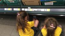 Mom defends disciplining her daughters with a time-out on the supermarket floor