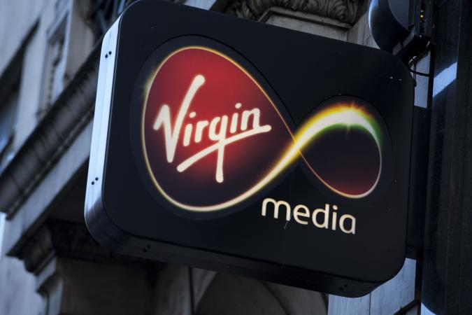 Sign for Virgin Media shop. (Photo by In Pictures Ltd./Corbis via Getty Images)