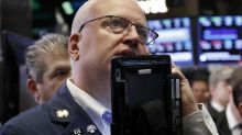 Stocks surge on earnings and economic data; Dow climbs 500