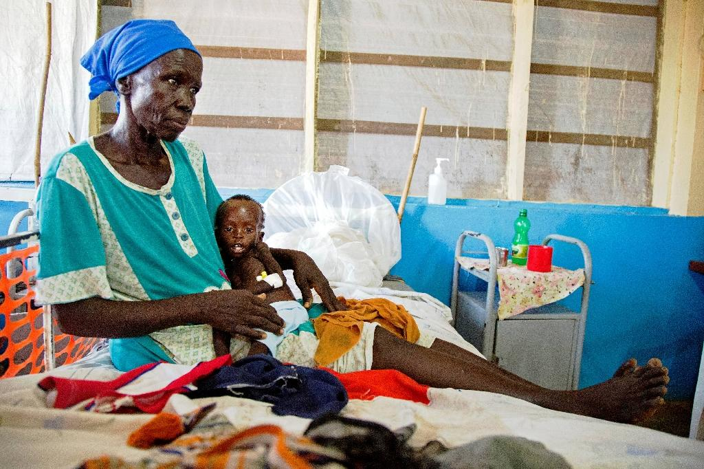 Regina Aluel holds her grandson Agop Manut, 11-months-old, who suffers acute malnutrition and respiratory distress at the clinic run by Doctors Without Borders in Aweil, northern Bahr al-Ghazal, South Sudan in 2016