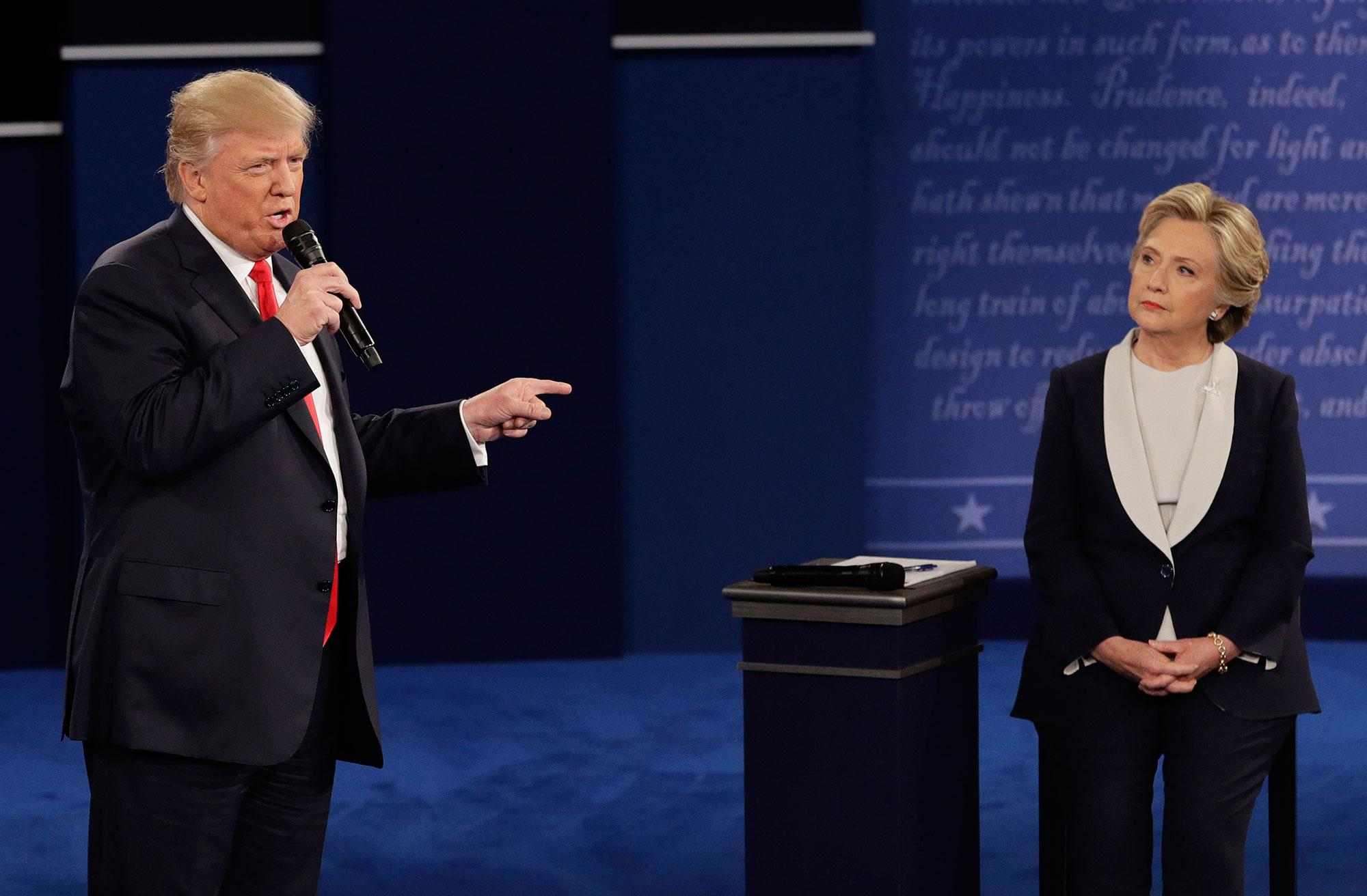 <p>Republican presidential nominee Donald Trump speaks to Democratic presidential nominee Hillary Clinton during the second presidential debate at Washington University in St. Louis, Mo., Sunday, Oct. 9, 2016. (Photo: John Locher/AP) </p>