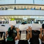 Hong Kong protesters let blank signs do the talking as new law bites